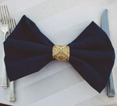 Bow tie napkins at each placesetting- LOVE!! // photo by Sarah Kathleen, via http://theeverylastdetail.com/romantic-glam-navy-pink-and-gold-wedding/