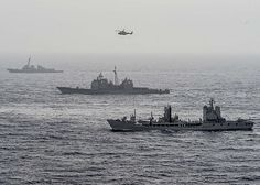 The guided-missile destroyer USS Roosevelt (DDG 80), top, guided-missile cruiser USS San Jacinto (CG 56), middle, and Italian navy participate in the Flotta Verde as part of the Great Green Fleet initiative.