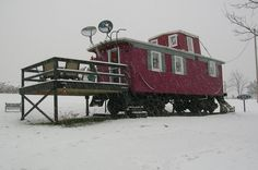 """Marcia Weber lives full-time in a Soo Line train caboose that was built in 1909. She purchased the caboose with her husband at the Tunerville Station in Whippany, New Jersey in 1975 from an ad in the Wall Street Journal that simply said """"wooden cabooses for sale."""""""