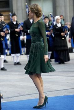 Princess Letizia in an emerald green sheer cocktail dress with a matching green suede pumps during the 'Prince of Asturias Awards 2013' ceremony at the Campoamor Theater in Oviedo, Spain.