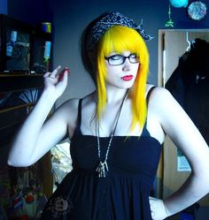 Yellow hair is difficult to pull off, yet she does it so well; I love the dress and necklaces too.