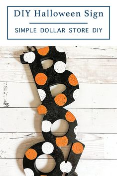 Make this cute and whimsical DIY Halloween sign with supplies from the dollar store and step by step instructions from Everyday Party Magazine #DIY #HalloweenDIY #DollarTreeCrafts