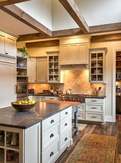 Soap Stone for a Farmhouse Kitchen with a Wood Beams and Pennsylvania Farmhouse Inspired Kitchen by Benbow & Associates