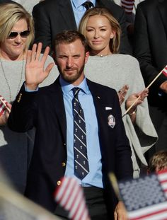 Dustin Johnson of the United States sits with Paulina Gretzky during the 2016 Ryder Cup Opening Ceremony at Hazeltine National Golf Club on September 29, 2016 in Chaska, Minnesota.