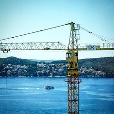 I found #trogir to be a rather #bustling community too with #cranes dotting the landscape for purposes of #construction & #port operations. This one just happened to be alongside a #bluff overlooking the bay. #croatiancoast #croatia