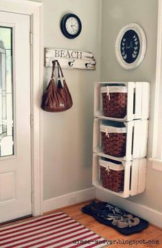 Entryway organization idea using wooden crates & baskets