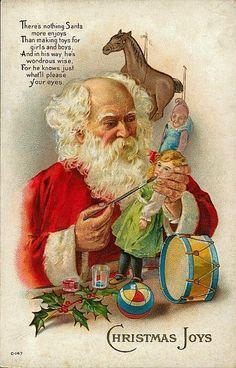 Santa Claus in his toy shop