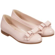 Girls pink leather pumps by Il Gufo. Made in shiny patent leather, these smart shoes have a bow detail at the front, are slip-on and fully lined in soft leather, with non-slip rubber soles.
