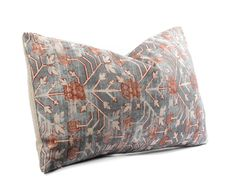 This pillow cover is sewn from Zak + Fox Khotan fabric in the Rubia colorway on front, featuring a blue base with rust and ivory accents. Please note that the pillow cover you order is cut from the same fabric as pictured, however, the exact pattern placement will most likely vary.  PILLOW COVER SIZE: 11x19 finished size, which is measured from pillow cover center to center (not corner to corner). The edges are tapered by approximately 0.5 on each side to accommodate a professional fit. You…