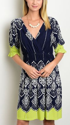Island Inspired Navy Lime V-Neck Ruffle Sleeve Surplice Print Dress, A bold print with hints of lime gives this boxy fashion dress a key-west feel. Surplice bodice, with a deep v-necklines adds seduction to this straight silhouette dress.
