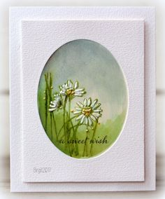 hanmade card by Birgit ... Rapport från ett skrivbord: A sweet wish ... ... watercolor of daisies in oval mat ... luv the framed look for this mini work of art ...