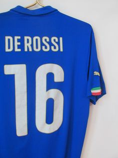 Italy home Daniele De Rossi football shirt by Puma National Football Teams, As Roma, Jersey, Football Shirts, Rome, Italia, Football Jerseys, Rum, Soccer Jerseys
