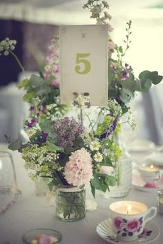 Jam jars with lovely cottage flowers; BEAUTIFUL.