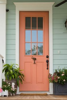 Pastel hues and a palmetto door knocker make this front door the epitome of Charleston style and Charleston architecture design. Deck out your own door with these stunning door knockers. #charleston #charlestondesign #frontdoor #doorknocker #exteriordesign Green Exterior Paints, Exterior Color Palette, Exterior Paint Colors For House, Paint Colors For Home, Exterior Paint Color Combinations, House Exterior Color Schemes, Bungalow Exterior, Craftsman Exterior, Cottage Exterior