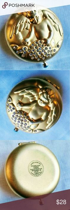 """Estee Lauder Vintage Angel Compact December 1997 was the year Estee Lauder launched their """"Angel"""" series of golden collectable powder compacts. They originally came in a box with a paper description of the angel. This is the December Angel: the angel of responsibility. The sparkling gems are all present. The rich gold tone has worn a bit on the angel's hip. The puff and powder are gone (just a trace remains...Enough to smell sweet;). We don't have the original box or paper. Zoom in #4 to see…"""