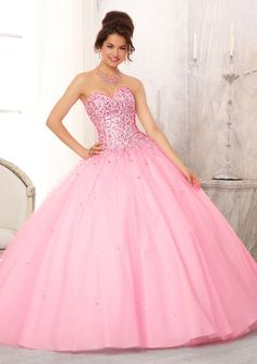 Quinceanera dresses by Vizcaya 88084 Multi-Colored Jewel Beaded Bodice on a Tulle Ball Gown Skirt Matching Bolero. Colors Avalable: Pucker Up Pink, Light Blue, White. Sizes Available: 2-24.