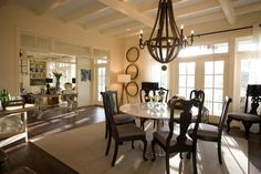 Dining room.  Coffered ceiling.  Large lighting pendant.