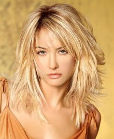 Textured cut medium length hairstyle with face framing layers.Light brown highlights applied on the top of golden blonde the hair to have an attractive look.