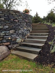 This elevated patio near Middlebury, VT allows the clients a spectacular sunset view and access to the lower lawn from the upper sunroom. Wall is granite from Whitehall, NY, patio and steps are PA Bluestone.