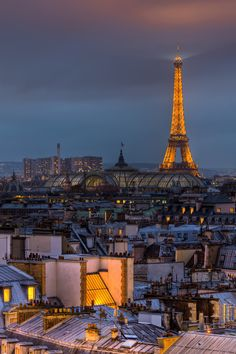 Eiffel Tower at night by Christian Müller on 500px - La Tour Eiffel with the glass roof of the Grand Palais in front of it