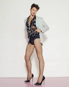 Ezra Miller stuns with Gender-fluid looks in 'Playboy' cover shoot.