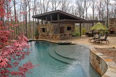 Perfect back yard. Outdoor kitchen, outdoor fireplace, gorgeous arbor and table setup, beautiful pool!