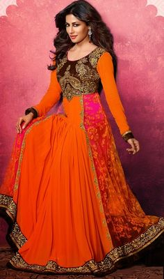 Make a stand-out statement as Chitrangada Singh, by owning this orange, pink and saddle brown georgette and net floor length Anarkali suit. The beautiful lace, resham, stones and velvet patch work a intensive characteristic of this attire. #BollywoodDressesCollection