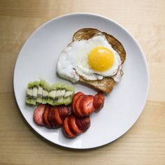 egg on whole wheat toast with fresh kiwi and strawberries. breakfast of champions.