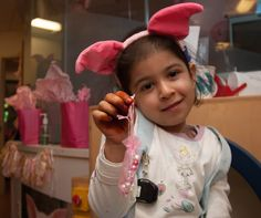 The Jimmy Fund Clinic's annual Pig Party was held yesterday marking the ninth celebration of a beloved tradition for #NationalPigDay! Doctors, nurses, & Jimmy Fund Clinic staff dressed up in pig ears and pink shirts, and patients enjoyed pig-themed arts & crafts. 🐷🐽