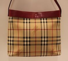 "Burberry - Haymarket Check Tote  This gorgeous Burberry Tote is detailed in red leather including the shoulder strap.  It has the traditional Burberry Haymarket Check pattern with the horse emblem.  It has a clasp closure and nice roomy interior pocket. Dimensions: 11""l x 9.5""h x 3.5""w.  Previously loved.  http://www.handbagconsignmentshop.com/bags/handbags/burberry-haymarket-check-tote/"