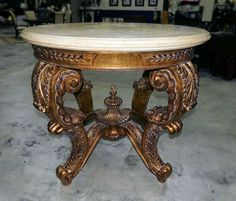CARVED WOOD ROCOCO GILT WOOD CENTER TABLE WITH TRAVERTINE MARBLE TOP