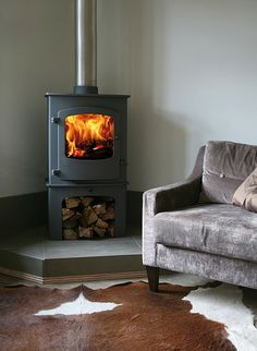 The Charnwood Cove Two Wood Burning Stove with the log store.