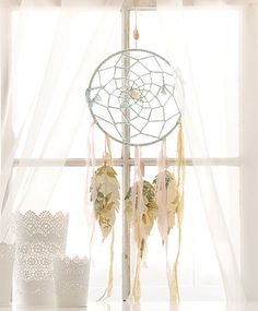 Johanna Love created this whimsical dream catcher from objects found in her garage. Find her DIY instructions for replicating the piece in  Somerset Home Volume 9.