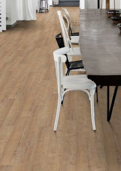 Hydrocork Flooring by Wicanders. Proudly distributed in NZ by Quantum. Why cork? A lifetime guarantee on an eco-friendly solution that is waterproof and tested for quiet and comfort. Floating Floor, Cork Flooring, Carpet Tiles, Porcelain Tile, Acoustic, Pine, Eco Friendly, Dining Chairs, Ceramics