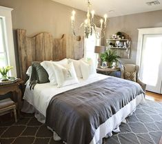 neutral bedroom--headboard, chandelier, cute chair next to table, decor, greys and browns??  Love it!