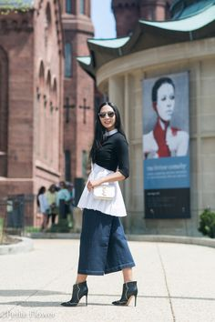 pleated white cotton top with navy denim culottes and black boots