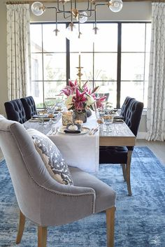 This blue faded rug adds subtle elegance to this chic dining room.