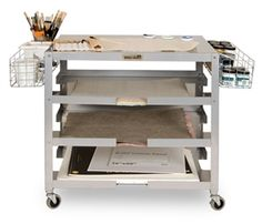 rolling cart with shelves and baskets on the sides. could be a good makeshift studio on wheels.