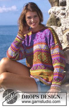 DROPS sweater with multicolored borders in Muskat