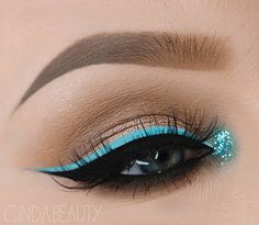This lady used smarter blue color in eye makeup combining it with black eyeliner and crayon. The eyes are highlighted, and your favorite blue has found its place in the makeup.