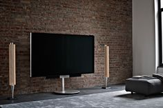 BeoVision Avant with two BeoLab 18 on the side! A great way to complement your home decor with Bang & Olufsen.