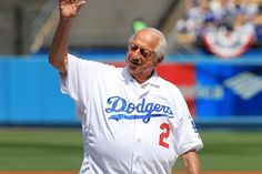Tommy Lasorda waited outside the Los Angeles Dodgers clubhouse long after Justin Turner hit a walk-off, three-run homer to give the Dodgers a 4-1 win and a 2-0 series lead over the Chicago Cubs in the NLCS on Sunday night at Dodger Stadium....