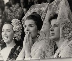Watching a bullfight: Jackie Kennedy (centre) and the Duchess (right) are seen wearing traditional Spanish veils alongside the Countess of Quintanilla (left)