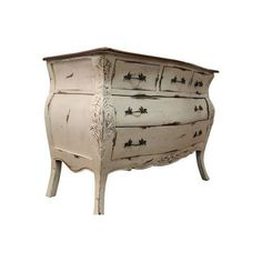 Shipping is NOT included. Contact us for prices and more pictures.  Country French Distressed Painted Carved Bombay-Style Dresser  Offered is a nice painted Country French Bombay-Style dresser. It has a nice white wash distressed finish to it in order to give it the feeling of being an older piece