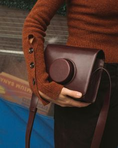 Lemaire's camera bag is already a firm favourite. Shop the brand via Farfetch BTQ Voo Store now.
