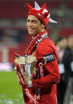Cristiano Ronaldo holds the Carling Cup trophy at Wembley in 2009.