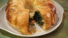 This Phyllo Spinach Pie tastes amazing! You can even freeze ahead and serve at a later date!  ingredients PHYLLO SPINACH PIE 2 tablespoons butter (plus 2 sticks of butter, melted for brushing) 1/2 cup scallions (chopped) 4 packages frozen chopped spinach (thawed and drained) 6 eggs 1/2 pound feta cheese (crumbled) 8