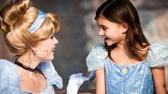 Cinderella greets a little girl dressed as Cinderella