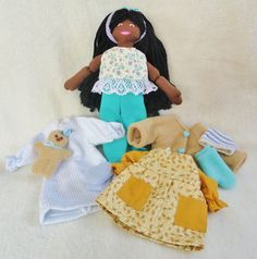 African American Dress Up Doll with 4 outfits, $40