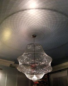 Californication Dream Space designed by Jamie Drake: Paper clip chandelier by Gary Ponzo made from over 4,000 little clips. Illuminated by half-silvered bulb.